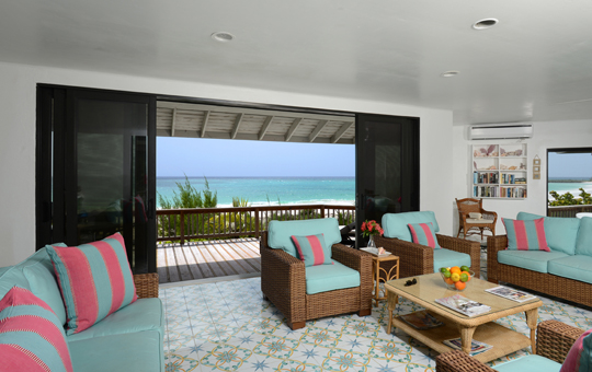 The living area opens onto the terrace and the beach