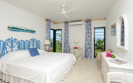 The blue bedroom: upgraded air-conditioning throughout the house